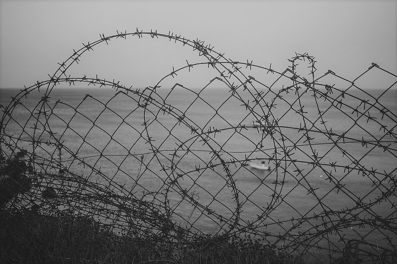 limit barbwire fence
